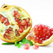 Pomegranate fruits with green leaf and cuts isolated on white ba — Stock Photo