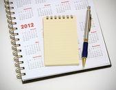 Stylo et cahier de calendrier 2012 — Photo