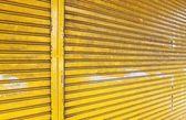 Illuminated grunge metallic roll up door — Stock Photo