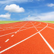 Running track with sky and clouds — Stock Photo