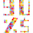 Letter numbers made of colorful beads on white background — Zdjęcie stockowe