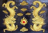 Two golden dragons (Chinese: Long) wood carving in black backgro — Photo