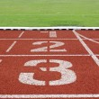 Running track numbers one two three in stadium — Stock Photo #13442873