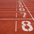 Stock Photo: Starting lane of running track
