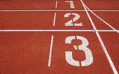 Running track numbers one two three in stadium — 图库照片