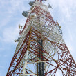Red and white tower of communications with their telecommunicati — Stock Photo