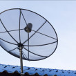 Black satellite dish, blue sky — Stock Photo