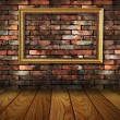 Foto de Stock  : Old grunge interior frame against wall