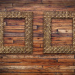 Two bamboo frames on wood wall — Stock Photo