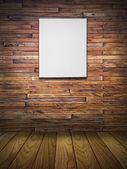 Leeg doek op houten muur in vintage kamer — Stockfoto