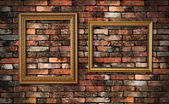 Grunge wall and two frames for fill picture in — Стоковое фото