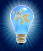 Puzzle in lightbulb as a concept of business — Stock Photo