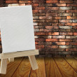 Foto Stock: Wood easel with white canvas in vintage room wood floor