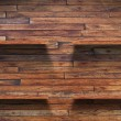 Empty wood shelf on wooden wall — Stock Photo