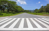 Zebra traffic walk way, cross way with blue sky — Stock Photo