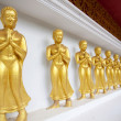 Foto Stock: Buddhdisciples on white wall