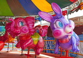 Carousel on a carnival Merry Go Round. — Stock Photo
