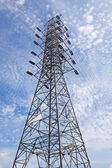 High voltage post.High-voltage tower sky background. — Photo