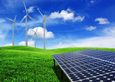 Solar cell energy panels and wind turbine — Stock Photo