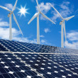 Solar panels and Wind Turbines sunny day blue sky — Stock Photo