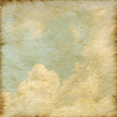 Old Mulberry paper texture background with a cloud and blue sky — Stock Photo