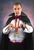 Portrait of a handsome young man in a suit of Count Dracula — Stock Photo