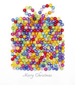 Gift box made of colorful beads on white background — Stock Photo