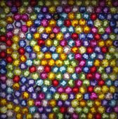 Colorful beads on black background — Stock Photo