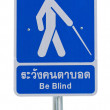 Beware crossing sign blind — Stock Photo
