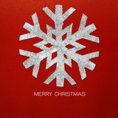 Christmas snowflake on red paper card — Stock Photo