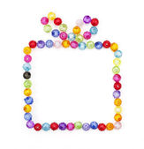 Gift box made of colorful beads on white background — Photo