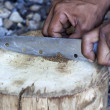 Stockfoto: Hand splitting Marihuanby knife
