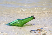 Bottle with message on the beach — Stok fotoğraf