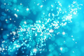 Light blue bokeh background — Stock Photo