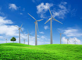 Wind turbines farm on green field landscape — Стоковое фото