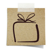 Hand draw gift box on note taped recycle paper — Stock Photo