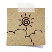 手在便条贴回收纸上绘制太阳和云 — 图库照片