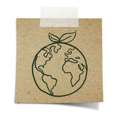 Hand draw green earth with leave on note taped recycle paper — Stock Photo