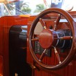 Steering wheel on a luxury yacht cabin. - Stockfoto