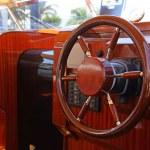 Steering wheel on a luxury yacht cabin. — Stock Photo #22903896