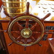 Steering wheel on a luxury yacht cabin. - Stock Photo