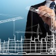 Business man drawing construction site — Stock Photo #28283965