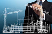 Business man drawing construction site — Stock Photo