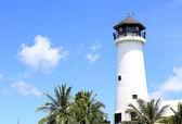 Lighthouse at the marina against blue sky — Stock Photo
