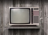 Old television on wood shelf background — Zdjęcie stockowe