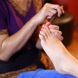 Reflexology foot massage, spa foot treatment by wood stick,Thail — Stock Photo
