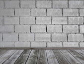Grey brick wall and wooden floor — Stock Photo