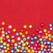Abstract Colorful beads on red background — Stock Photo