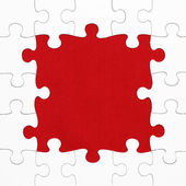 Jigsaw puzzle on red background space for edit text or picture — ストック写真