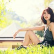 Portrait of beautiful young asian woman in the park — Stock Photo